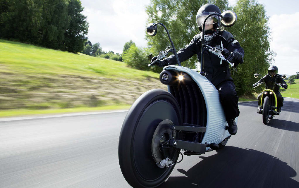 Rider driving a Johammer J1.200 on a highway