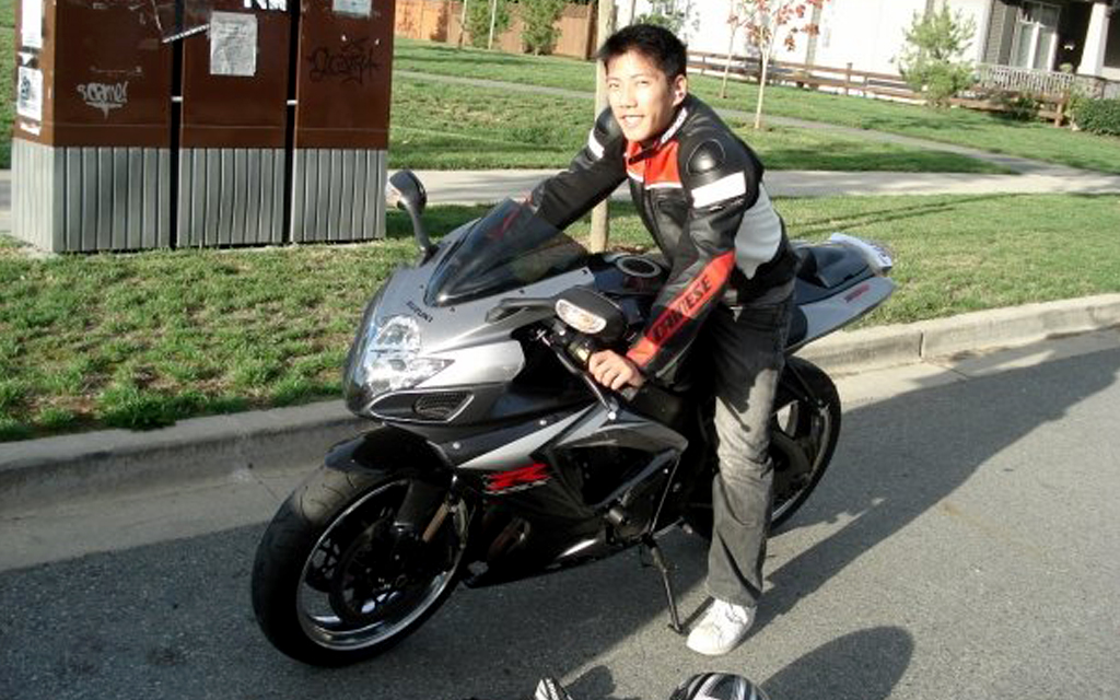 Mike Tang, VP of Finance at Damon Motorcycle on his gray sport bike ready for a city drive