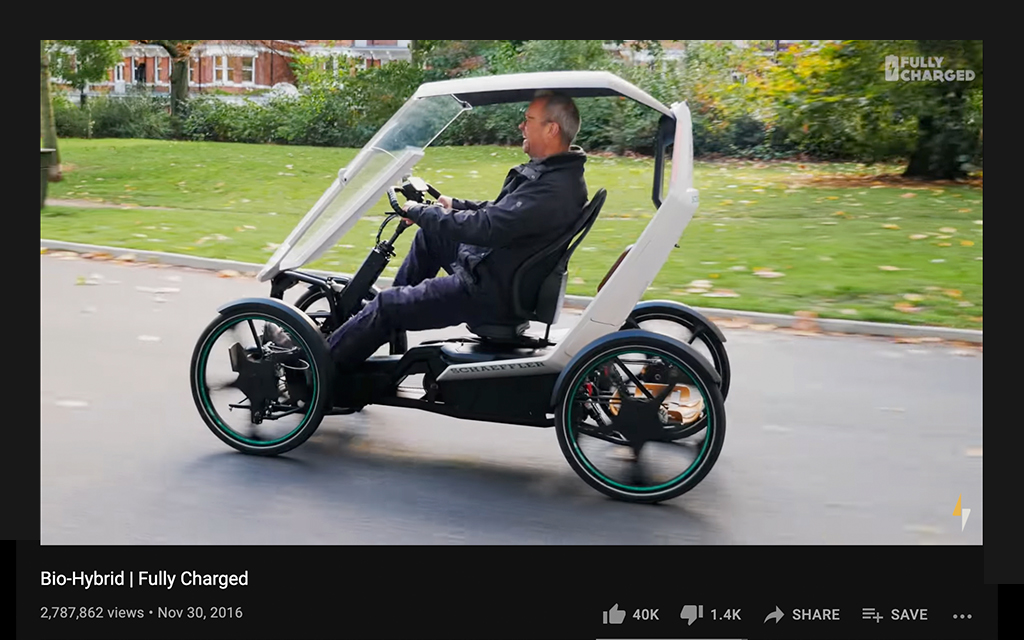 FullyCharged youtuber on his electric vehicle riding by the city