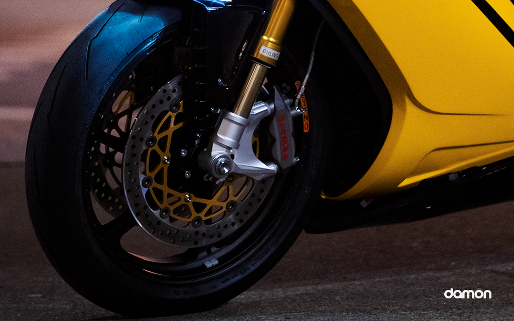 Close look of the wheel of a yellow Damon HyperSport