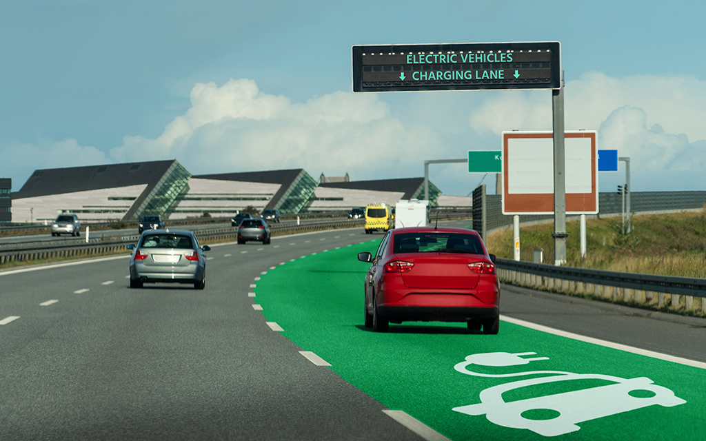 Highway with a charging lane for electric vehicles.