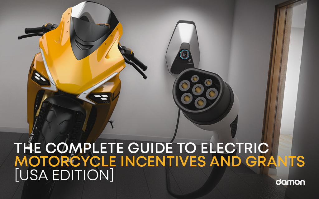 Yellow Damon Electric HyperSport Right next to a electric motorcycle charger