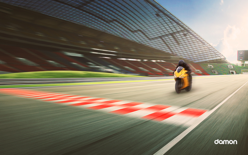 Driver on a Damon's Yellow HyperSport on high velocity on a raceway